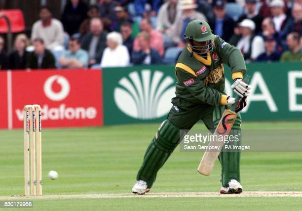 Bangladesh's capatin Aminul Islam hits four runs off New Zealand bowler Dion Nash during their Cricket World Cup 1999 match at Chelmsford