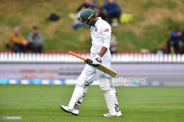 Bangladesh's captain Mahmudullah walks from the field after being caught during day three of the second Test cricket match between New Zealand and...