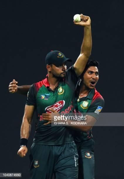 Bangladesh's captain Mashrafe Mortaza celebrates after he dismissed Pakistan's batsman Shoaib Malik during during the one day international Asia Cup...