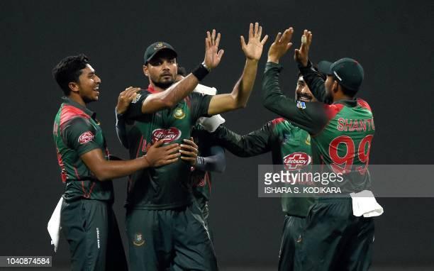 Bangladesh's captain Mashrafe Mortaza celebrates after he dismissed Pakistan's batsman Shoaib Malik during the one day international Asia Cup cricket...
