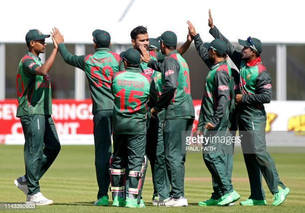 Bangladesh's captain Mashrafe Mortaza celebrates with teammates after taking the wicket of West Indies' Sunil Ambris during the TriNation Series one...
