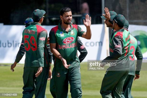 Bangladesh's captain Mashrafe Mortaza celebrates with teammates after taking the wicket of West Indies' captain Jason Holder during the Tri-Nation...