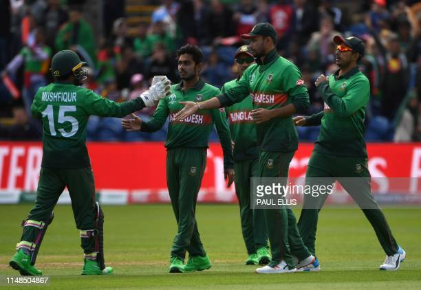 Bangladesh's captain Mashrafe Mortaza celebrates with teammates after taking a catch to dismiss England's Jason Roy during the 2019 Cricket World Cup...