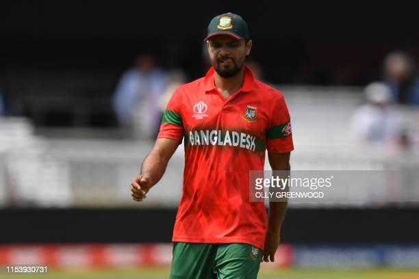 Bangladesh's captain Mashrafe Mortaza gestures during the 2019 Cricket World Cup group stage match between Pakistan and Bangladesh at Lord's Cricket...