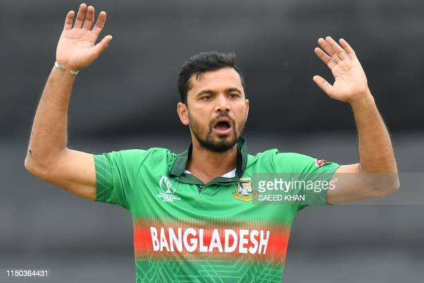 Bangladesh's captain Mashrafe Mortaza reacts as he bowls during the 2019 Cricket World Cup group stage match between West Indies and Bangladesh at...