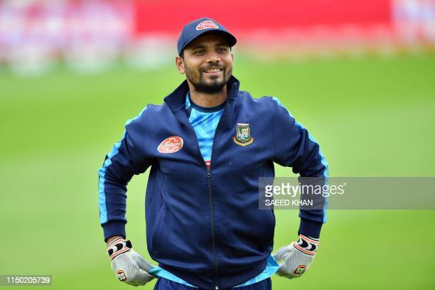 Bangladesh's captain Mashrafe Mortaza smiles during a training session at The County Ground in Taunton southwest England on June 16 ahead of their...