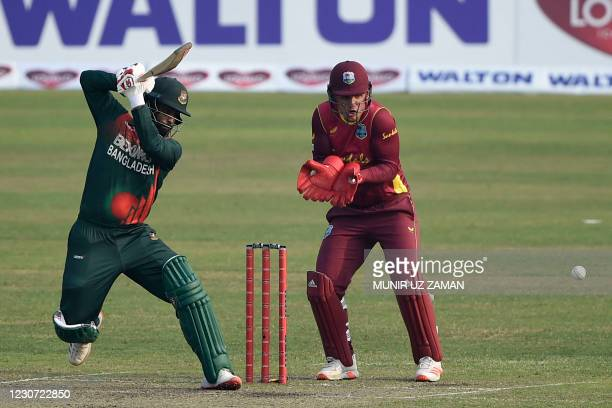 Bangladesh's captain Tamim Iqbal plays a shot as West Indies' wicketkeeper Joshua Da Silva watches during the second one-day international cricket...