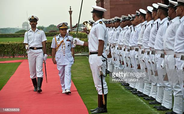 Bangladesh's Chief of the Naval Staff Vice Admiral Zahir Uddin Ahmed inspects the guard of honor prior to a meeting with India's Naval Chief Admiral...