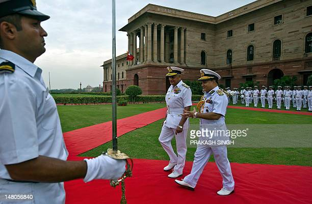 Bangladesh's Chief of the Naval Staff Vice Admiral Zahir Uddin Ahmed talks with India's Naval Chief Admiral Nirmal Verma after the guard of honor in...