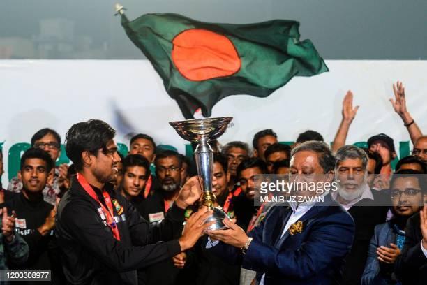 Bangladesh's Cricket Board President Nazmul Hasan Papon and Bangladesh's Under19 cricket team captain Akbar Ali hold the International Cricket...