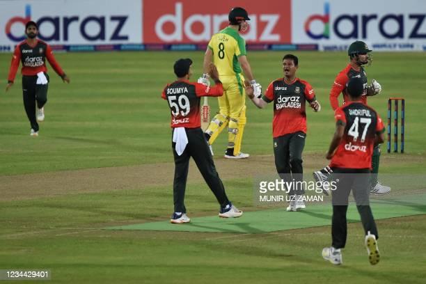Bangladesh's cricketers celebrate after the dismissal of Australia's Josh Philippe during first Twenty20 international cricket match between...