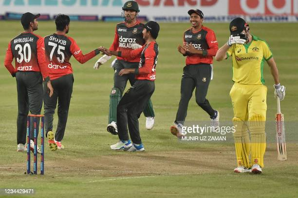 Bangladesh's cricketers celebrate after the dismissal of Australia's Moises Henriques during first Twenty20 international cricket match between...