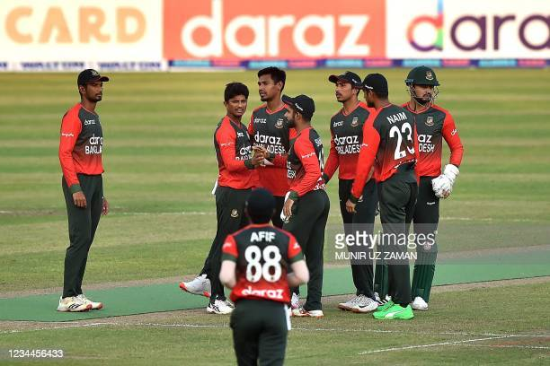 Bangladesh's cricketers celebrate after the dismissal of Australia's Alex Carey during the second Twenty20 international cricket match between...