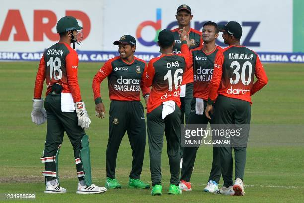 Bangladesh's cricketers celebrate after the dismissal of New Zealand's Cole McConchie during the first Twenty20 international cricket match between...