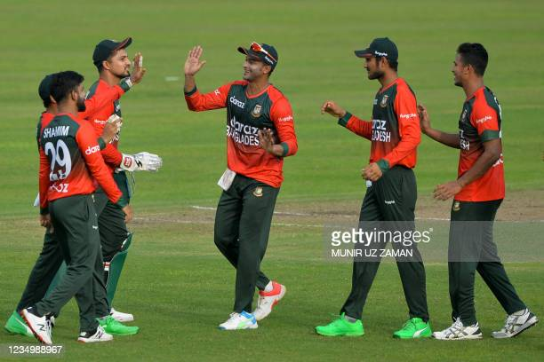 Bangladesh's cricketers celebrate after the dismissal of New Zealand's Henry Nicholls during the first Twenty20 international cricket match between...