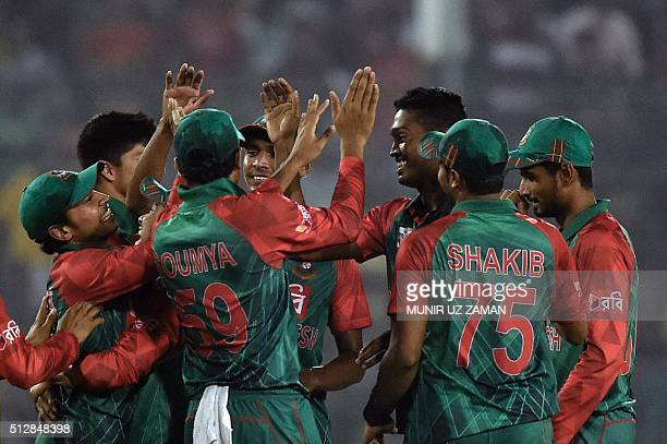 Bangladesh's cricketers celebrate after the dismissal of Sri Lanka's Dasun Shanaka during the Asia Cup T20 cricket tournament match between...