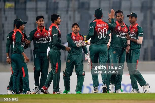 Bangladesh's cricketers celebrate after the dismissal of Zimbabwe's Tinashe Kamunhukamwe during the second Twenty20 international cricket match of a...
