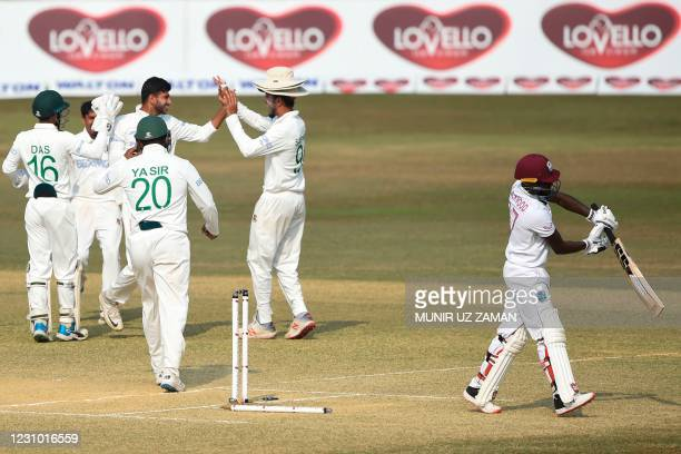 Bangladesh's cricketers celebrate the dismissal of West Indies' Jermaine Blackwood during the fifth day of the first cricket Test match between...