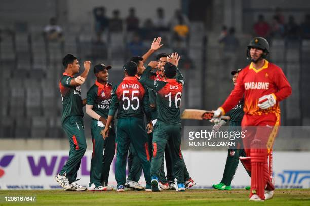 Bangladesh's cricketers celebrate the dismissal of Zimbabwe's Brendan Taylor during the first Twenty20 international cricket match of a twomatch...