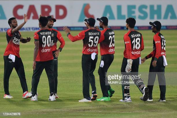 Bangladesh's cricketers celebrate their win in the first Twenty20 international cricket match against Australia at the Sher-e-Bangla National Cricket...