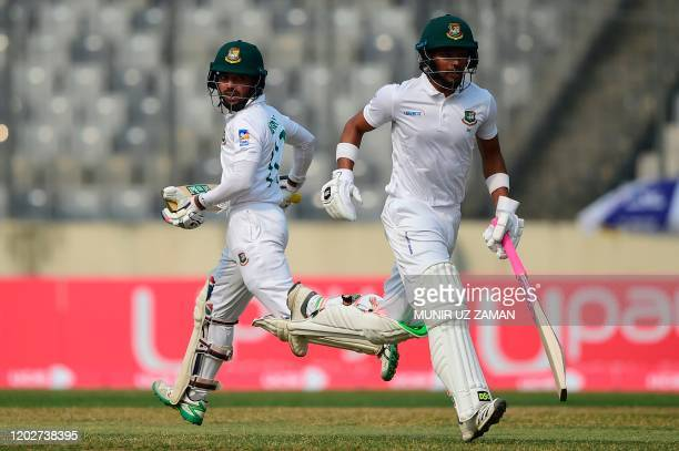 Bangladesh's cricketers Mominul Haque and Najmul Hossain Shanto run between the wickets during the second day of a Test cricket match between...