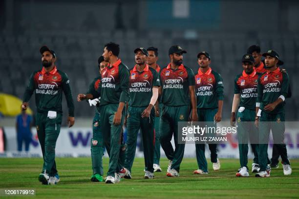 Bangladesh's cricketers walk off the field at the end of the first Twenty20 international cricket match of a twomatch series between Bangladesh and...
