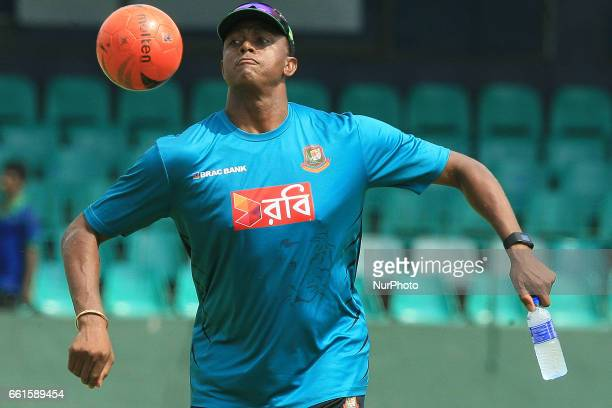 Bangladesh's fast bowling coach Courtney Walsh plays football during a practice session at the Sinhalease Sports Club Ground in Colombo on March 31...
