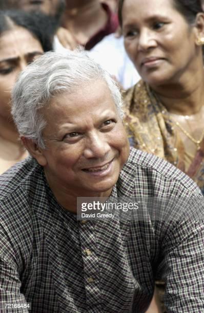 Bangladesh's first ever Nobel Peace Prize recipient Muhammad Yunus arrives at Grameen Bank on October 14 2006 in Dhaka Bangladesh Yunus and Grameen...