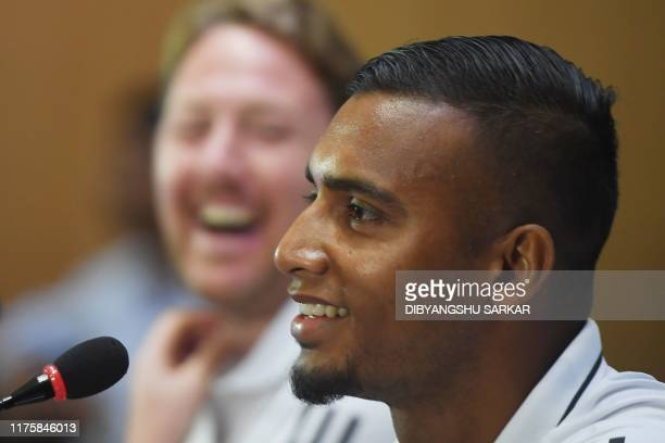 Bangladesh's football captain Jamal Bhuyan and coach Jamie Day react during a press conference on the eve of their World Cup 2022 andthe 2023 AFC...