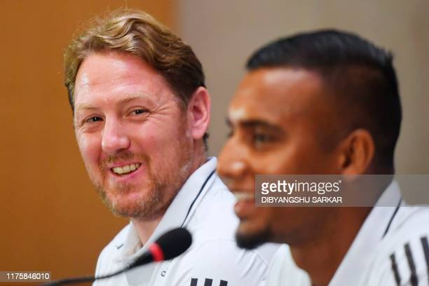 Bangladesh's football coach Jamie Day looks on next to Bangladeshi captain Jamal Bhuyan and gestures during a press conference on the eve of their...