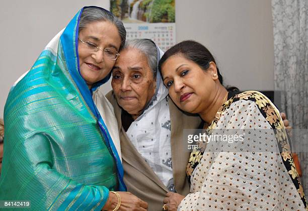 Bangladesh's former prime minister and Awami League chief Sheikh Hasina Wajed shares a moment with her sister Rehana and Khadina Hussain sister of...