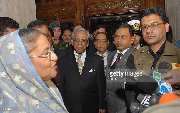 Bangladesh's former Prime Minister and Awami League chief Sheikh Hasina Wajed answers to journalists as she leaves a meeting with Chief Advisor of...