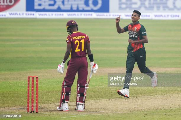 Bangladesh's Hasan Mahmud celebrates dismissing West Indies' Akeal Hosein during the first one-day international cricket match between Bangladesh and...