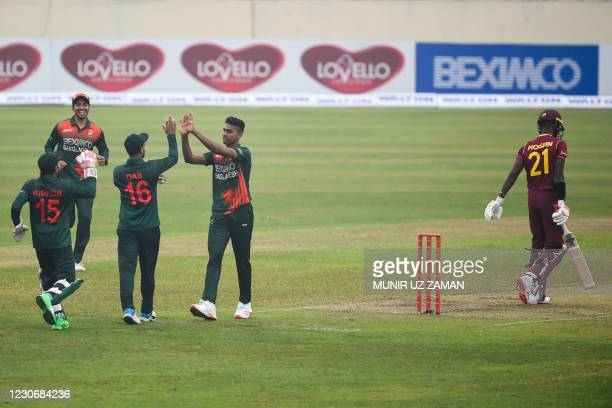 Bangladesh's Hasan Mahmud celebrates with teammates after dismissing West Indies' Akeal Hosein during the first one-day international cricket match...