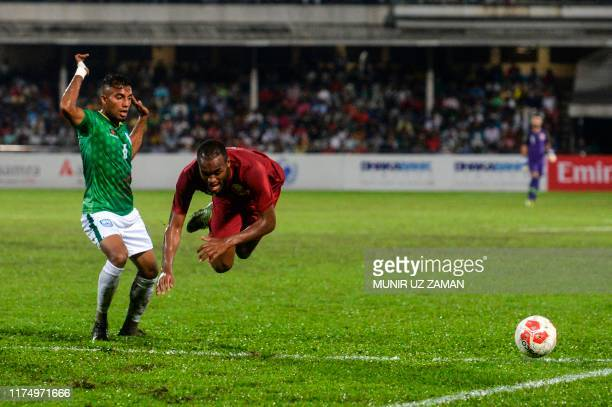Bangladesh's Jamal Bhuyan vies for the ball with Qatar's Abdelkarim Hassan during Asia Group EFIFA World Cup 2022 andthe 2023 AFC Asian...