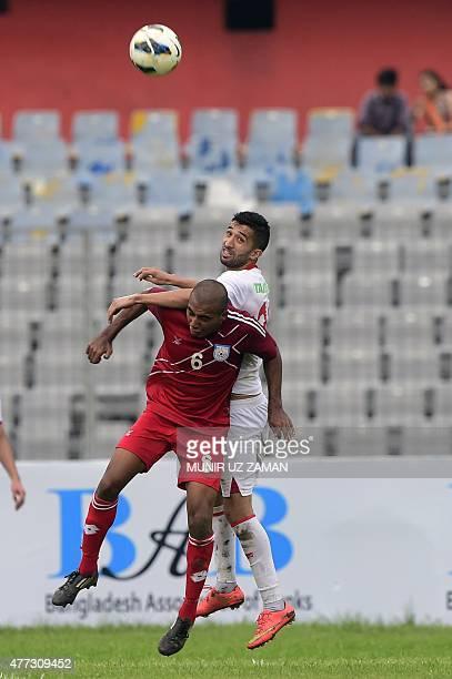 Bangladesh's Jamal Bhuyan vies for the ball with Tajikistan's Dzhalilov Manuchehr during the Asia Group B FIFA World Cup 2018 qualifying football...