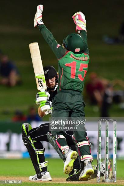 Bangladesh's keeper Mushfiqur Rahim shouts an unsuccessful leg before wicket appeal against New Zealand's Martin Guptill during the first oneday...