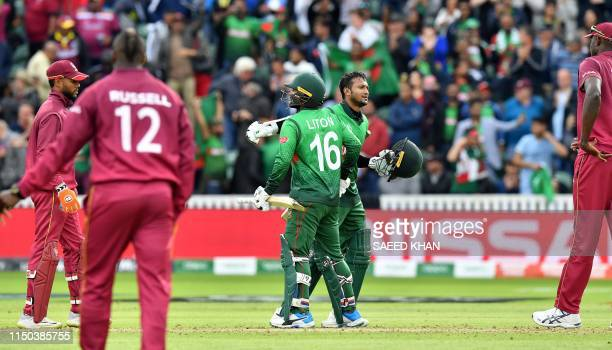 Bangladesh's Liton Das and Bangladesh's Shakib Al Hasan celebrates after winning the 2019 Cricket World Cup group stage match between West Indies and...
