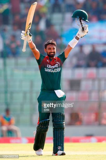 Bangladesh's Liton Das celebrates after scoring a century during the first one day international cricket match between Bangladesh and Zimbabwe at the...