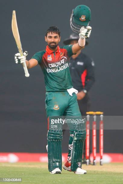 Bangladeshs Liton Das celebrates after scoring a century during the third one day international cricket match between Bangladesh and Zimbabwe at the...