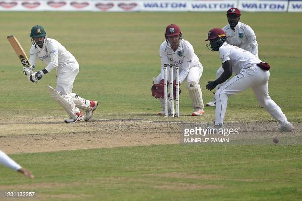 Bangladesh's Liton Das plays a shot as West Indies' wicketkeeper Joshua Da Silva with Jermaine Blackwood and Shayne Moseley watches during the third...