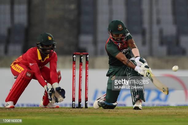 Bangladesh's Liton Das plays a shot as Zimbabwe's Richmond Mutumbami wicketkeeper watches during the first Twenty20 international cricket match of a...