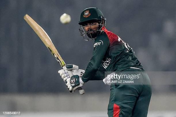 Bangladesh's Liton Das plays a shot during the second Twenty20 international cricket match of a two-match series between Bangladesh and Zimbabwe at...