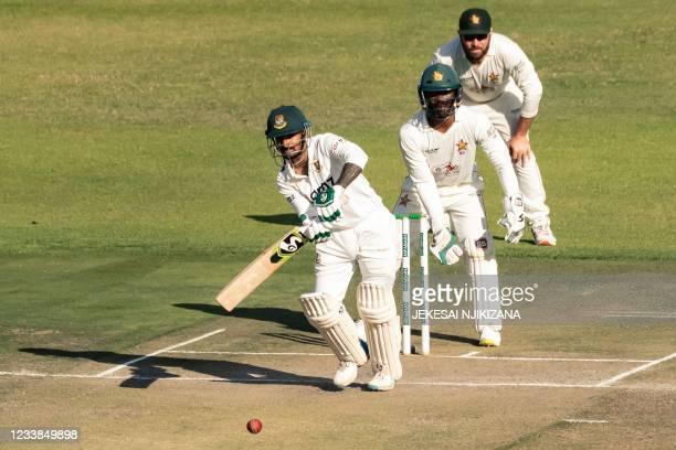 Bangladesh's Liton Das watches the ball after playing a shot as Zimbabwe's wicketkeeper Regis Chakabva and Zimbabwe's captain Brendan Taylor looks on...