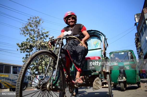 Bangladesh's lone female rickshawpuller Mosammat Jasmine poses on her batteryrun rickshaw in Chittagong city on January 15 2017 As Bangladesh's only...