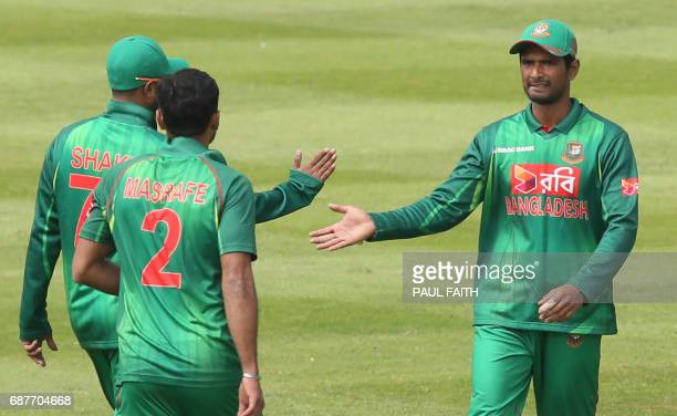 Bangladesh's Mahmadallah celebrates after catching out New Zealand's Jimmy Neesham during the TriSeries one day international cricket match between...