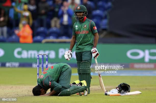 Bangladesh's Mahmudullah celebrates reaching 100 during the ICC Champions Trophy match between New Zealand and Bangladesh in Cardiff on June 9 2017...