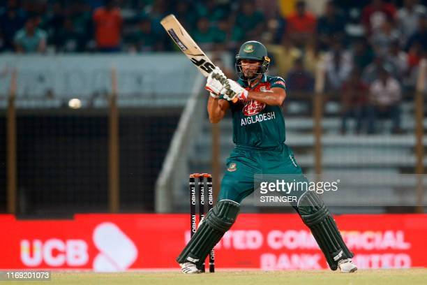 Bangladesh's Mahmudullah plays a shot during the fourth Twenty20 international match of a trination cricket series between between Zimbabwe and...