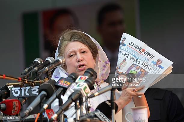 Bangladesh's main opposition leader and Bangladesh Nationalist Party chairperson Khaleda Zia holds a Bengali newspaper while addressing a rally in...