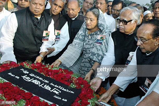 Bangladesh's main opposition party Awami League chief and former Prime Minister Sheikh Hasina Wajed and her party leaders place a wreath at the...